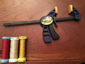 Silk & 2 weights of linen thread, cross-stitch needles, C-clamp.